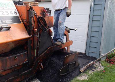 repairing an asphalt driveway in Anchorage, Alaska