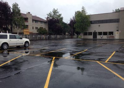 new asphalt parking lot with striping in Anchorage, Alaska